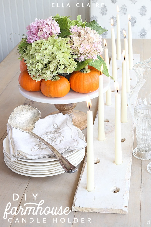 This wooden DIY rustic candle holder is a perfect centerpiece for a cozy vintage Fall feel
