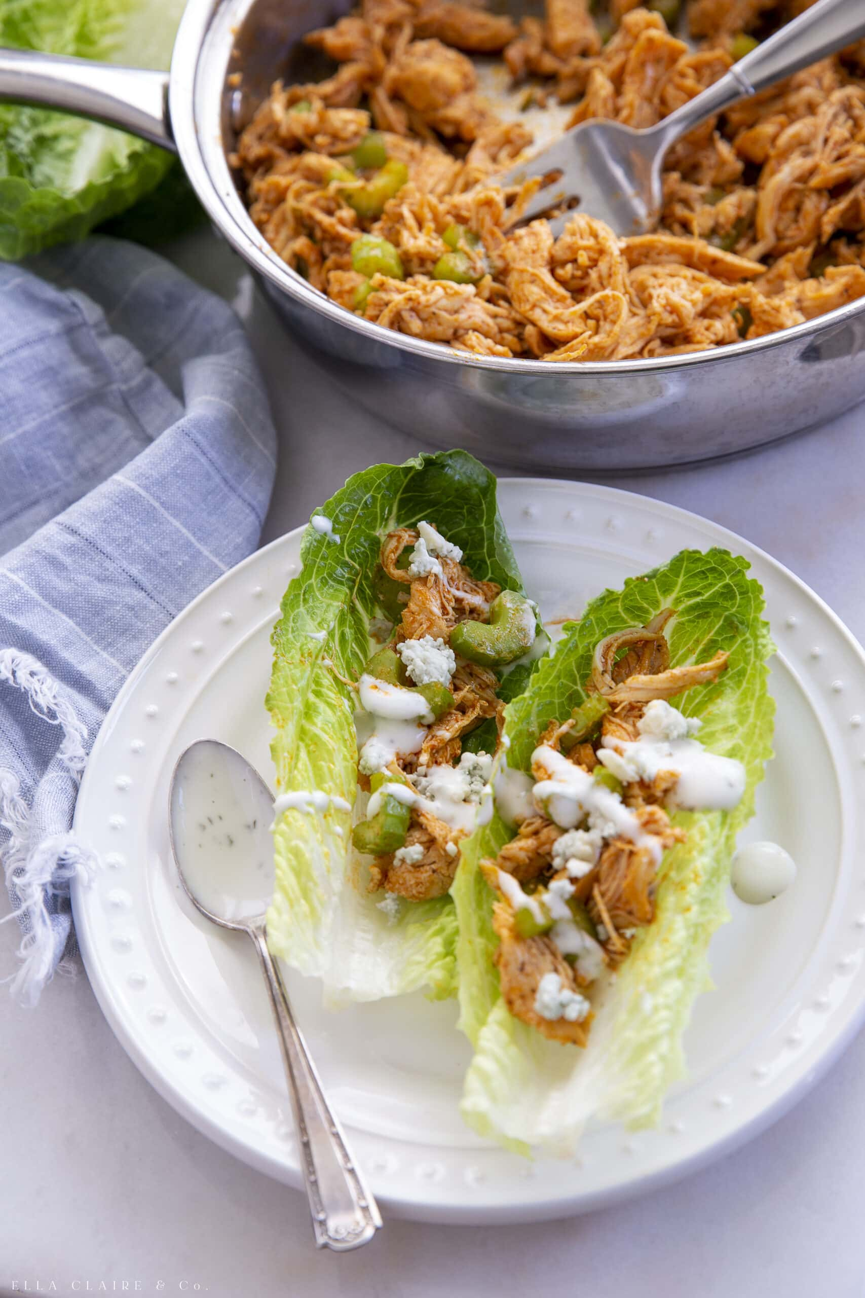 buffalo chicken lettuce wraps with blue cheese crumbles and ranch drizzle
