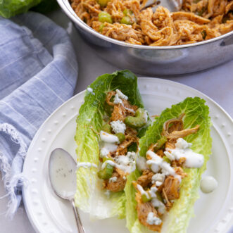 healthy buffalo chicken lettuce wraps drizzled with ranch
