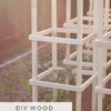 How to make easy, sturdy and inexpensive DIY wood tomato cages. They are both beautiful and functional and work so much better for heavy tomato plants than traditional wire ones. Ours are still going strong after 7 years!