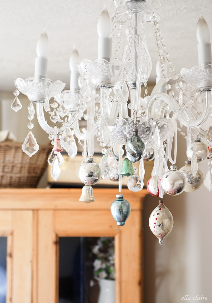 I love this idea of putting vintage Christmas ornaments on a chandelier!