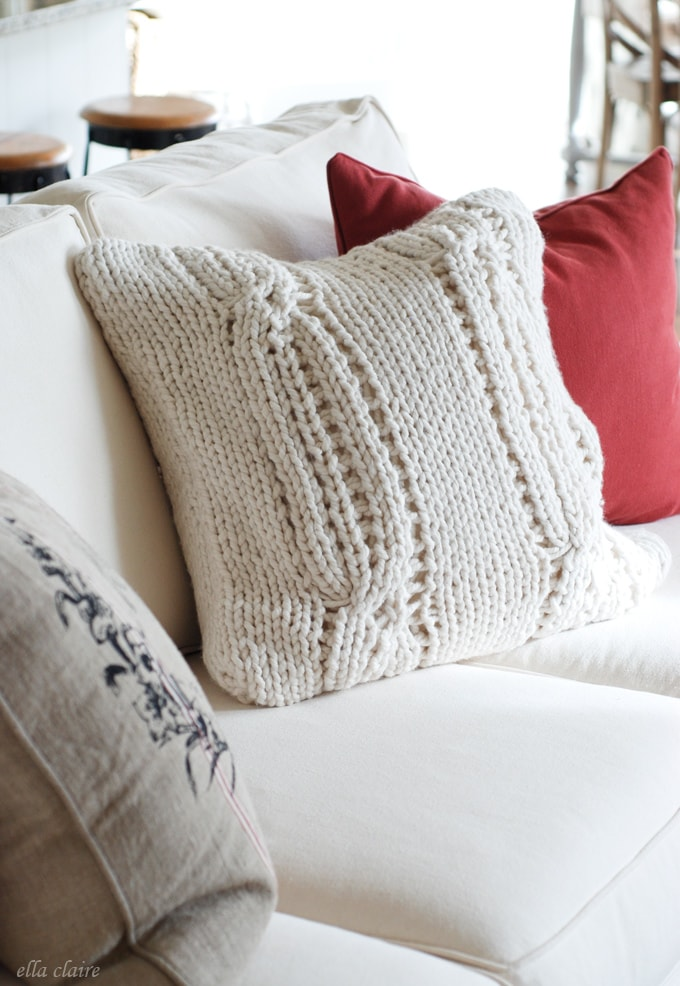 I love this slipcovered sofa set with fun pillows and gorgeous Christmas decor!