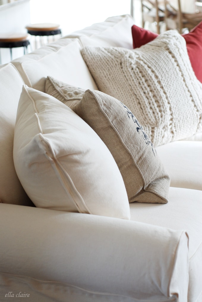 I love this slipcovered sofa set with these fun pillows!