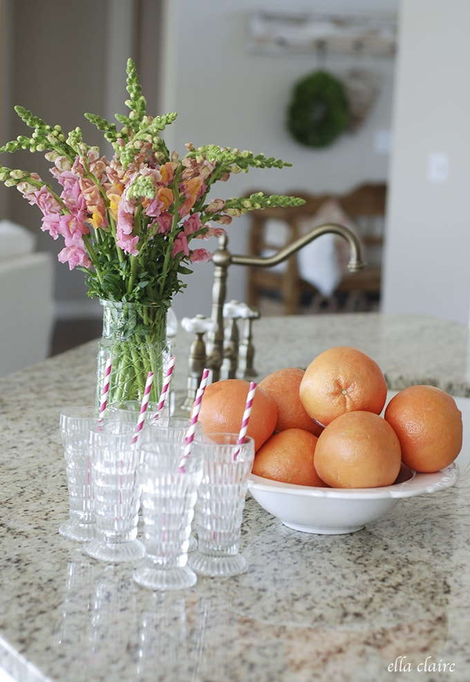 pretty vintage juice glasses, grapefruit, snapdragons | Ella Claire Summer Home Tour