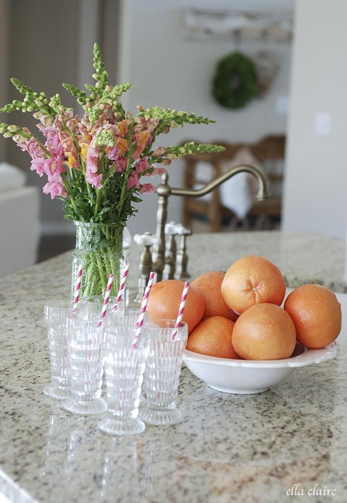 pretty vintage juice glasses, grapefruit, snapdragons | Ella Claire Summer Home Tour