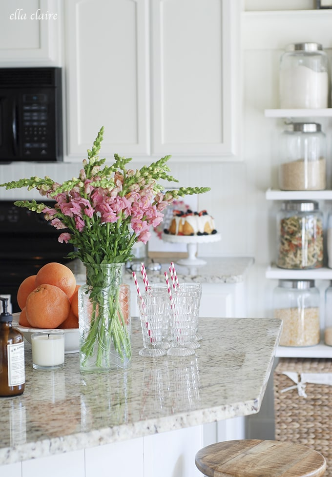 snapdragons and pretty vintage juice glasses | Ella Claire Summer Home Tour