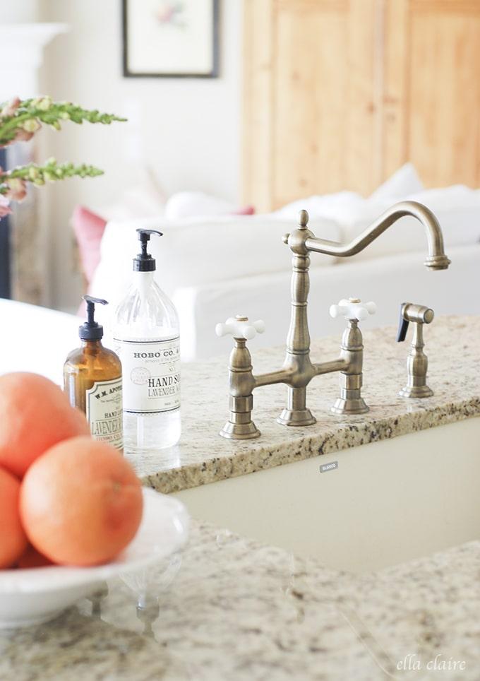 pretty faucet and soaps | Ella Claire Summer Home Tour