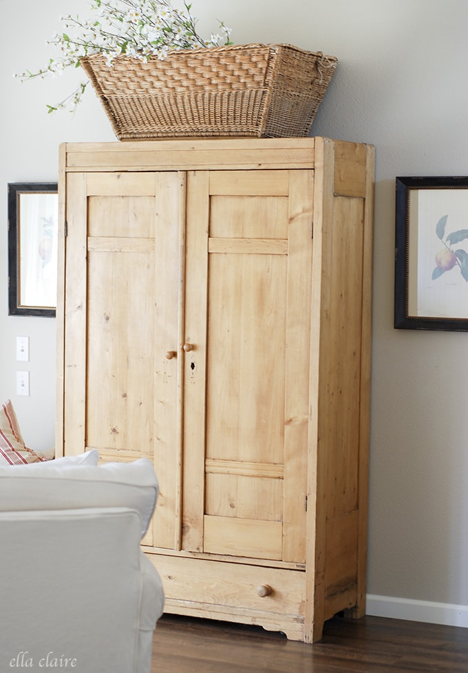 antique cabinet, french basket with flowers | Ella Claire Summer Home Tour