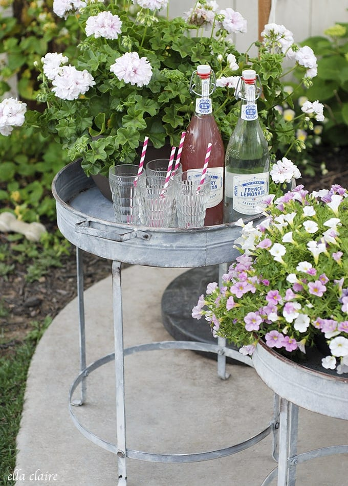 Gorgeous vintage inspired galvanized tray stands with french lemonades and vintage juice glasses