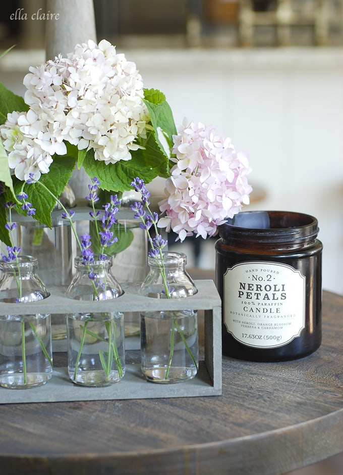 fun candle, bottles, hydrangeas and lavender