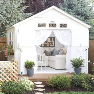 DIY backyard She Shed to relax, read, visit, and work with all the comforts of home. #homedecor #sheshed #farmhouse #momcave #cottagestyle #farmhousestyle #blue
