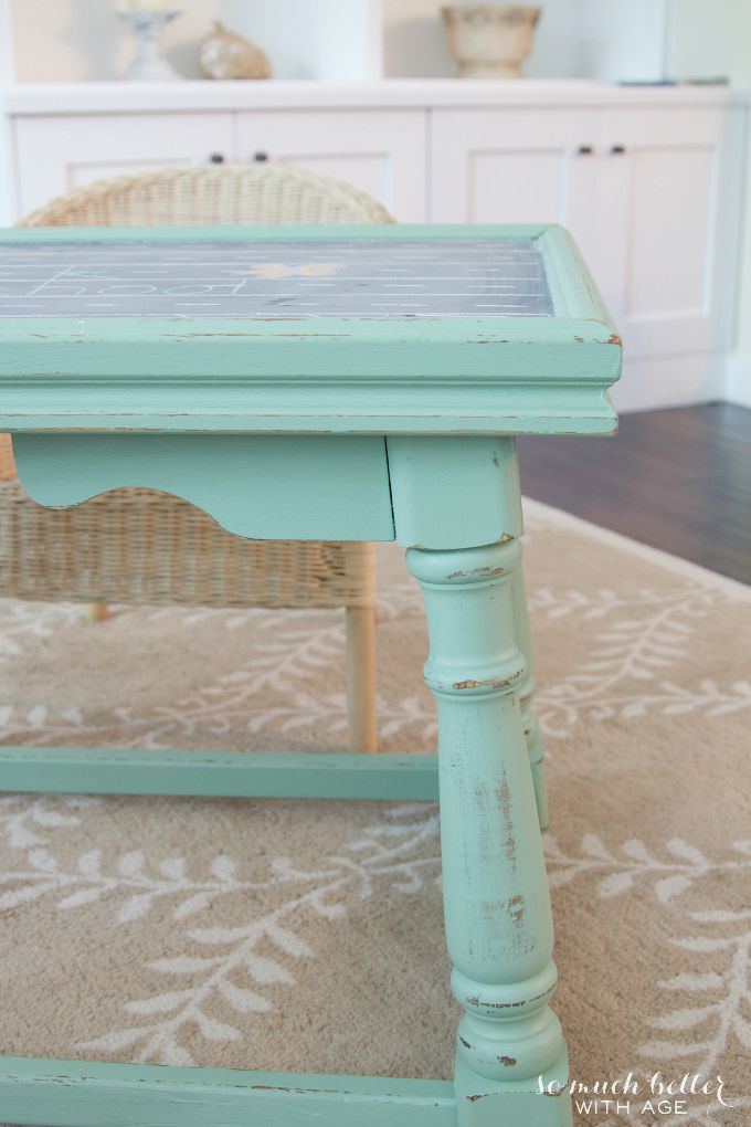 Green play table on light brown rug.