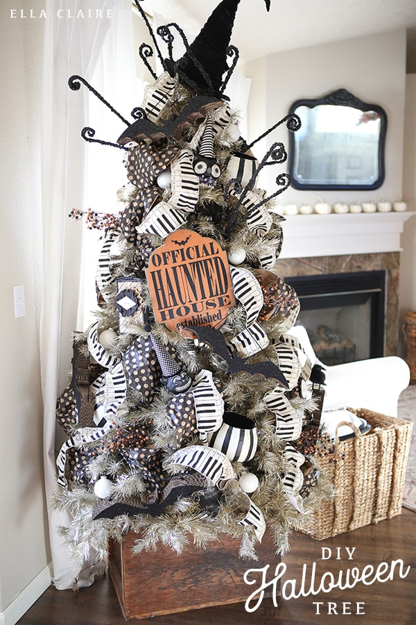 A unique and fun DIY vintage Halloween tree, complete with ornaments, ribbon, and homemade decorations #howtomake #awesome #decoratingideas #spooky #black #silhouette #orange