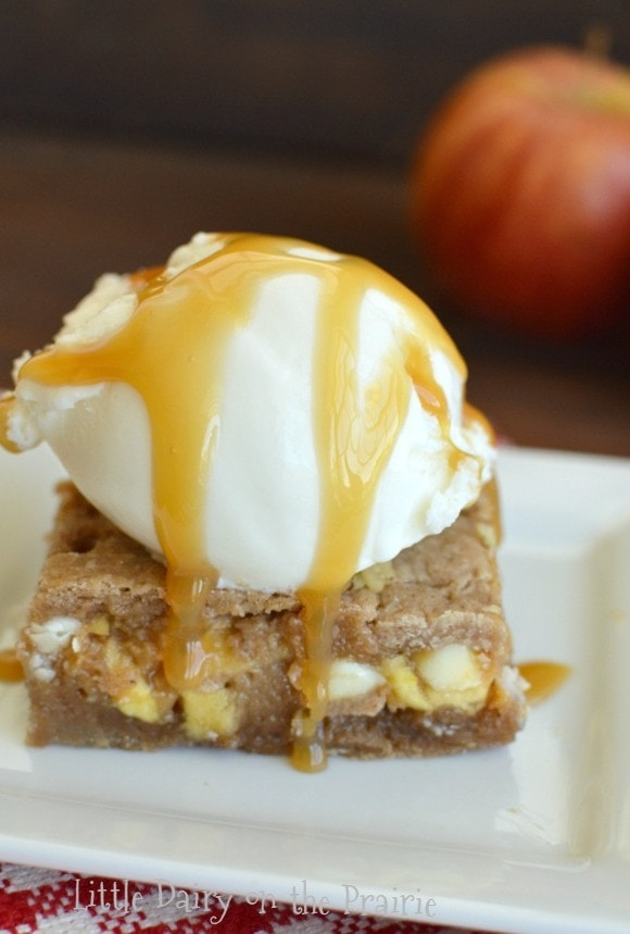 Warm and gooey Caramel Apple Blondies with a scoop of ice cream drizzled in caramel sauce is the ultimate in fall treats!  Little Dairy on the Prairie