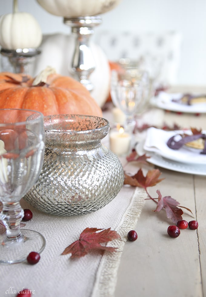 Thanksgiving Tablescape with pumpkins, leaves, berries, and mini pies at each place setting!