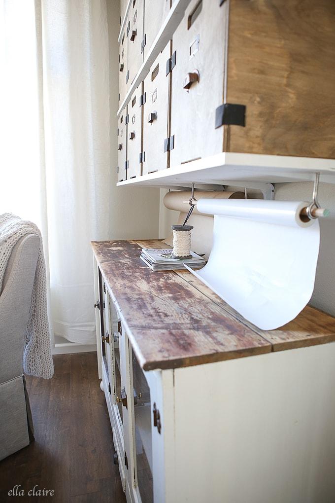 hanging paper rolls- Home Office/Studio Makeover