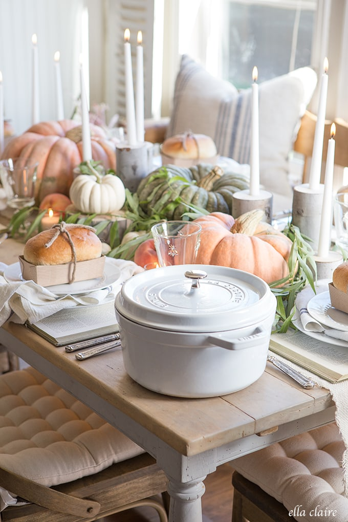 Farmhouse Fall Tablescape with Pumpkins, old books, soup and homemade bread