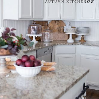 Sweet fall farmhouse kitchen with unique Autumn decor color scheme- plum, copper, ivory, rustic burnt orange #hometours #decorations #theme #table #falldecorating #falldecor #fallfarmhouse