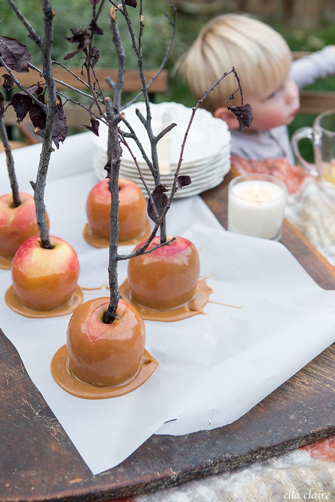 Cozy Fall Outdoor Table with hot wassail and caramel apples.