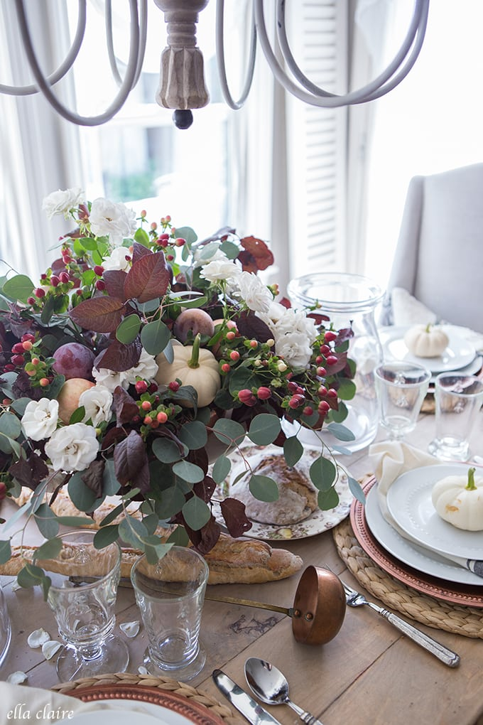 Fall Tablescape with white pumpkins, copper accents, and rich colors- burgundy, deep plum purple, and copper.