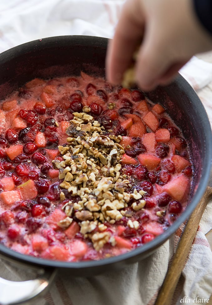 add walnuts to apple cranberry simmering sauce mixture