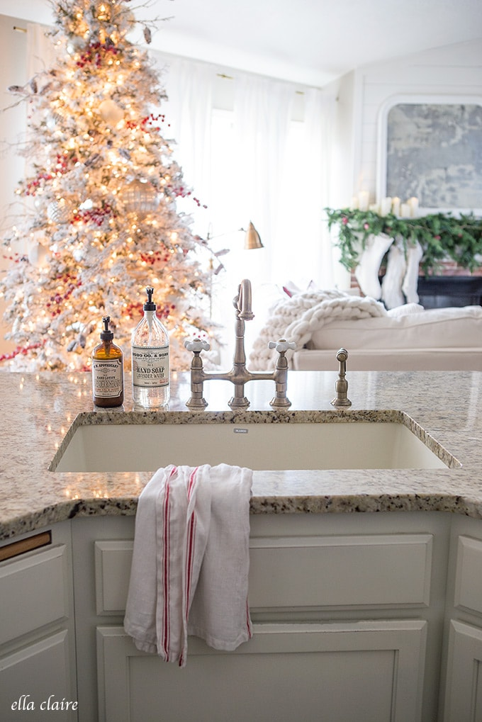 a vintage towel with red stripes adds a festive touch to a Christmas kitchen