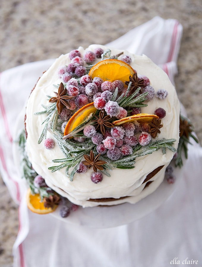Gingerbread cake with dried oranges, sugared cranberries, star anise and sugared rosemary adds rustic charm for holiday entertaining