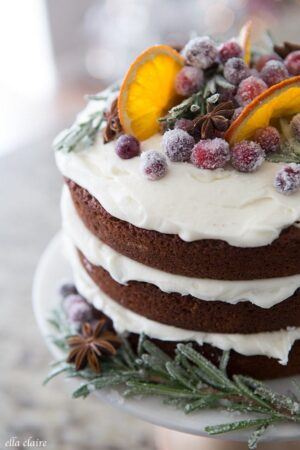 Gingerbread cake with dried oranges, sugared cranberries, star anise and sugared rosemary.