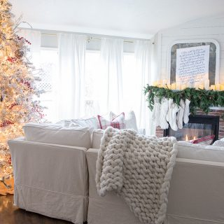 A cozy and inviting Christmas Family room- red, cream, plaid with vintage and traditional touches.