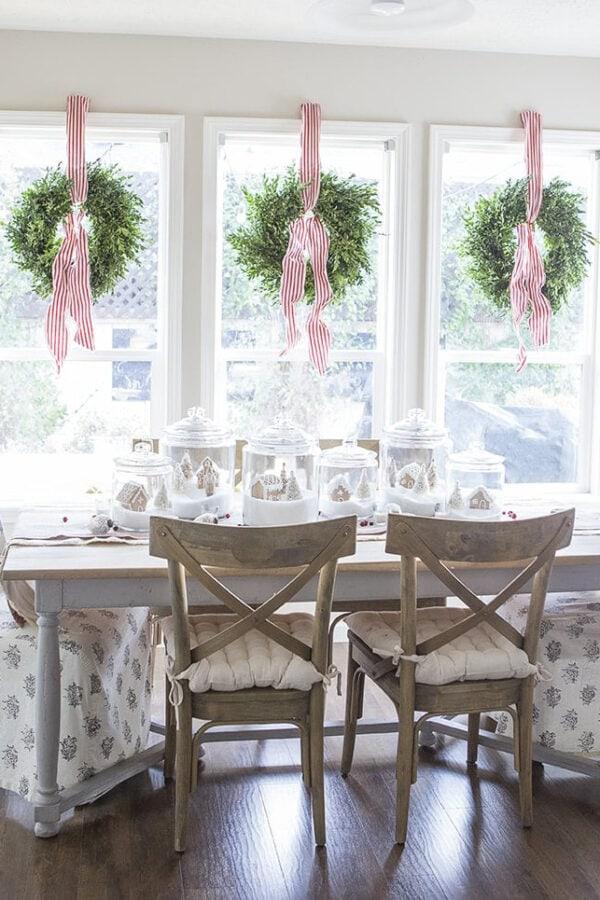 christmas jar village and wreaths on windows