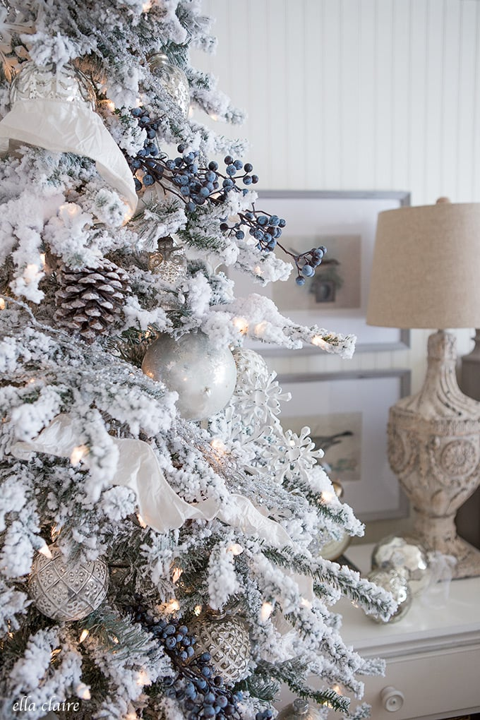 Christmas Bedroom with beautiful flocked Christmas tree, whites, grays, and fresh boxwood wreaths