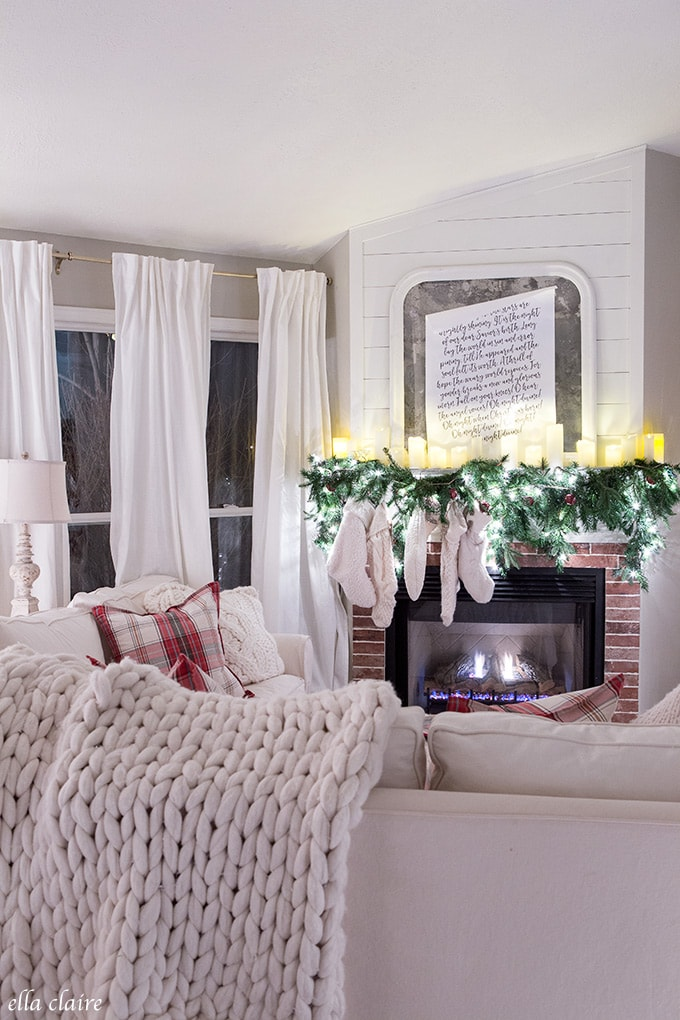 Charming Christmas Home at Night- Classic red, flocked tree, casual candles on mantel