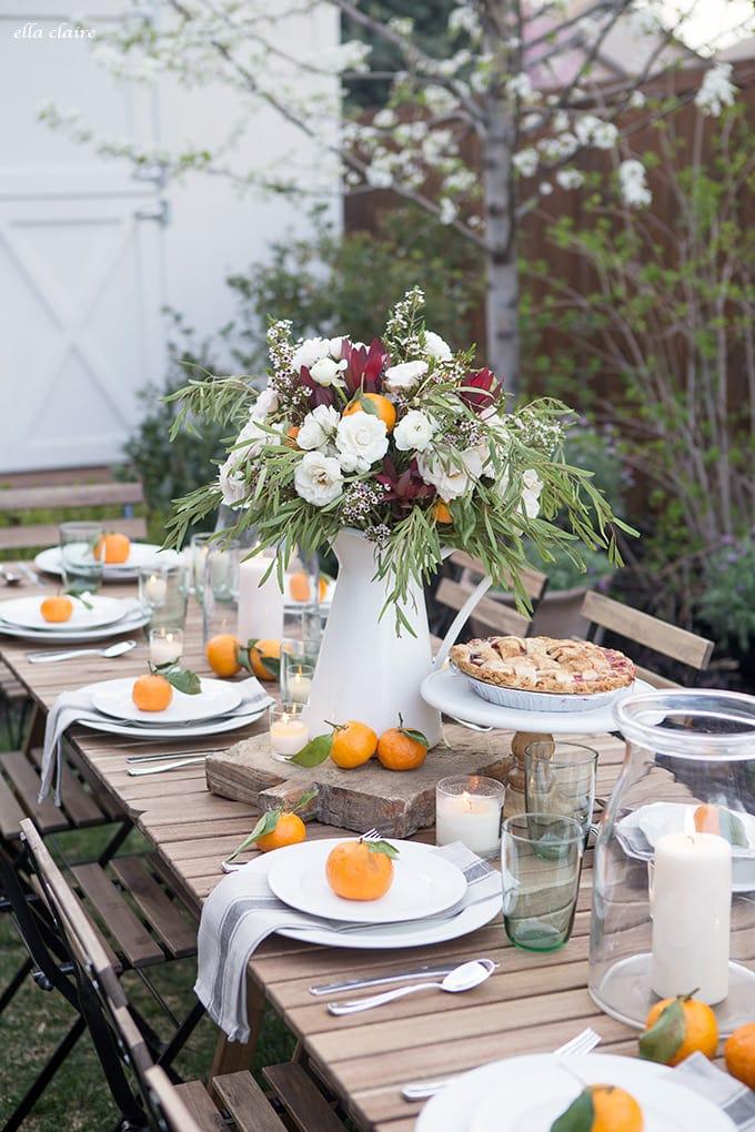 Simple Outdoor Entertaining using White Plates, linen napkins, vintage pieces