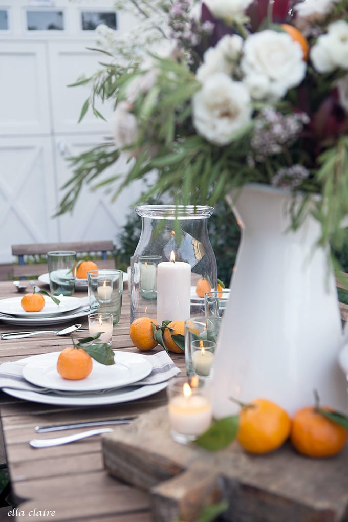 Simple Outdoor Entertaining- Hurricane lanterns and white candles