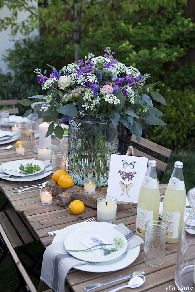 Candlelit outdoor entertaining with fresh graden flowers, lemons, and candles