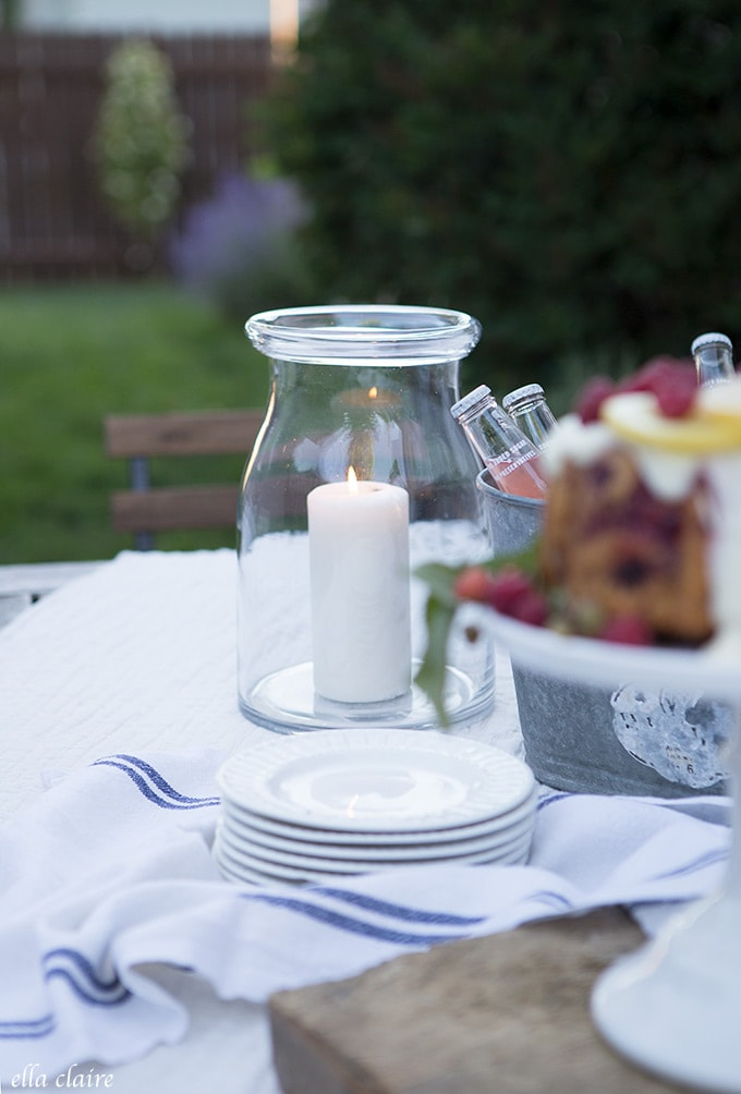 Candlelight in hurricane lanterns creates ambiance for entertaining outdoors