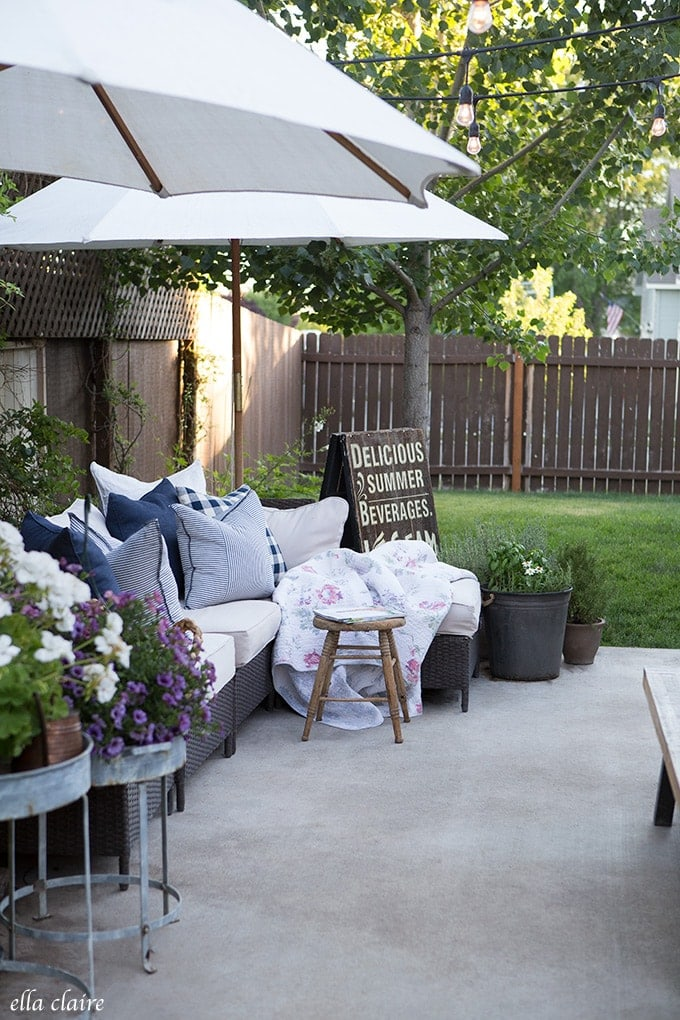 Cozy outdoor spaces include pillows and throws