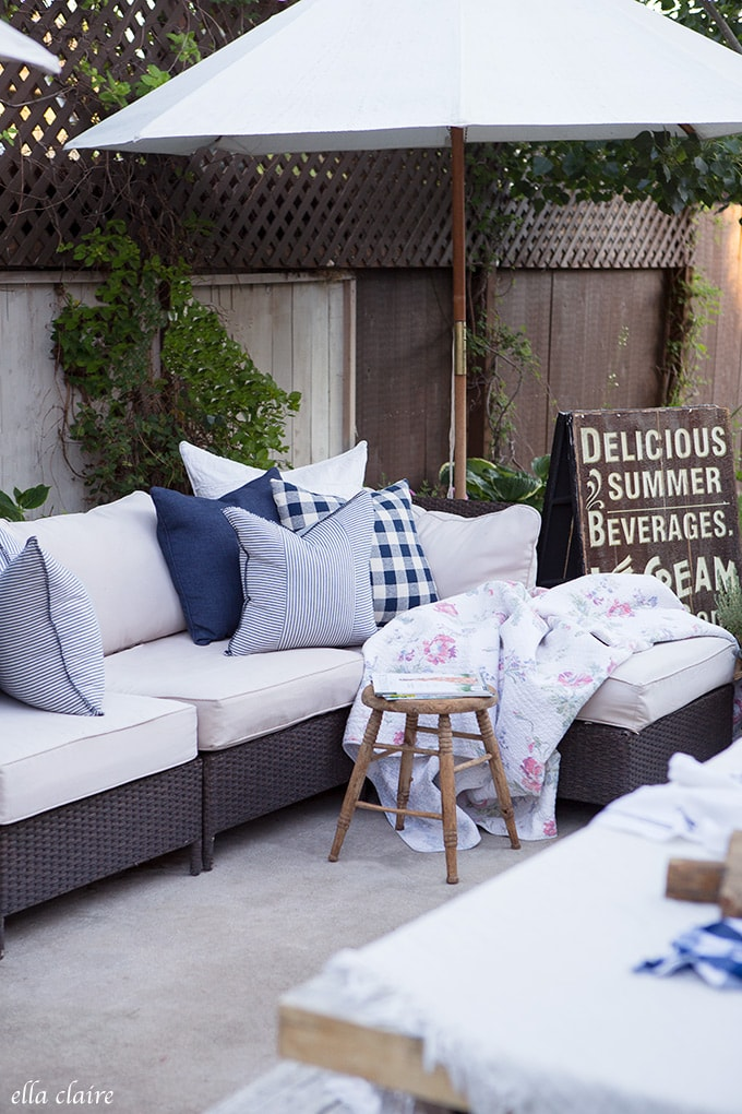 Adding a vintage inspired sign creates a cozy and charming space on the patio.