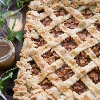 Fall slab apple pie- an easy way to entertain and feed a crowd. Homemade caramel sauce topping makes it really special- the best!