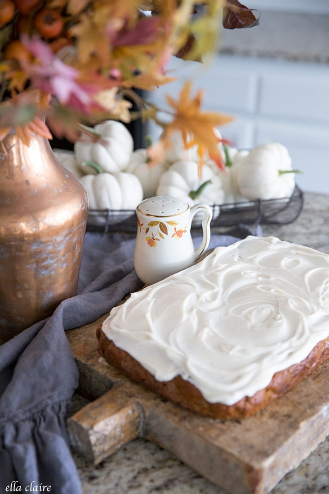 Pumpkin Snack Cake with Cream Cheese Frosting, white pumpkins, and vintage dishes in the Autumn leaf pattern.