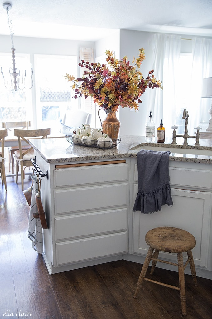 golden tones, warm burnt orange, copper, white pumpkins- timeless Fall decor accent this kitchen with vintage french country charm.