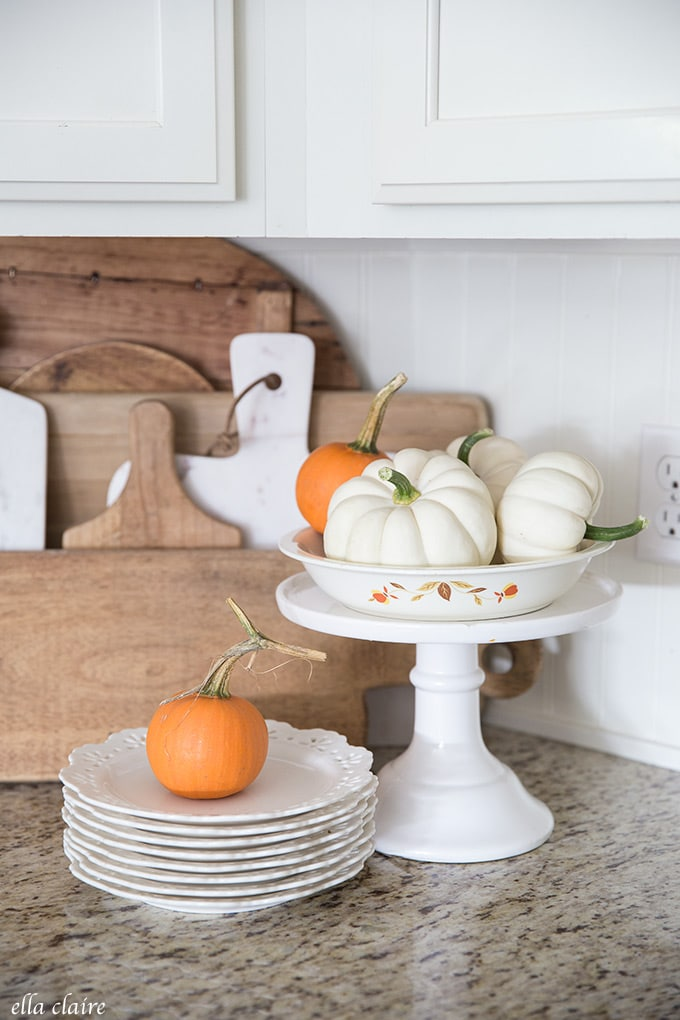 garden pumpkins and vintage dishes with the Jewel T Autumn Leaf pattern in a fall kitchen