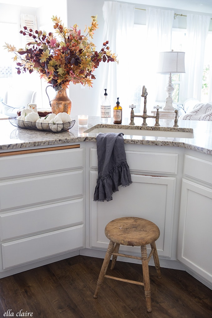 Classic vintage pieces, white pumpkins, copper, and all of the fall colors in this warm autumn kitchen