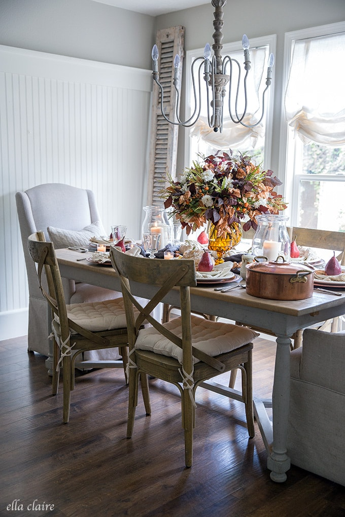 Amber glass, copper, antique dishes, candles- there perfect combination for a fall tablescape