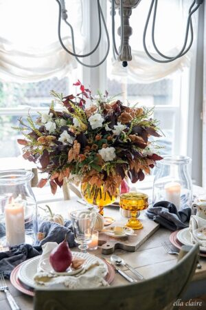 Fall tablescape with Amber, burnt orange, gold, white, warm tones for autumn entertaining.
