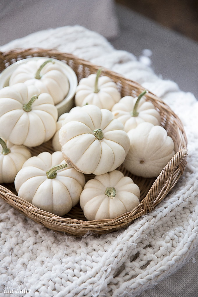 white pumpkins in a basket for a simple warm and cozy fall decoration