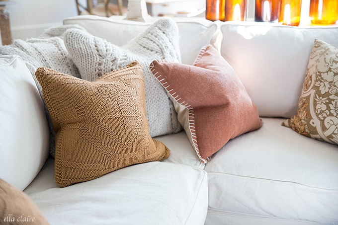 Nutmeg and golden mustard colored pillows for a warm and inviting fall decoration color scheme