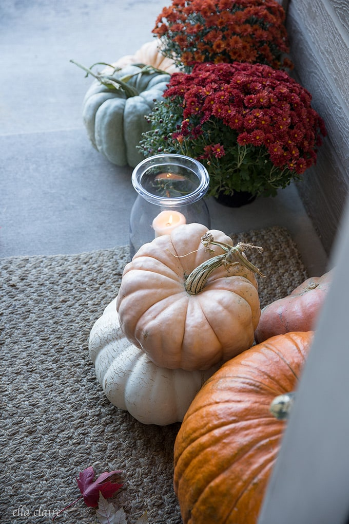 beautiful autumn gourds and fairytale pumpkins in the candlelight on a sweet little fall porch.
