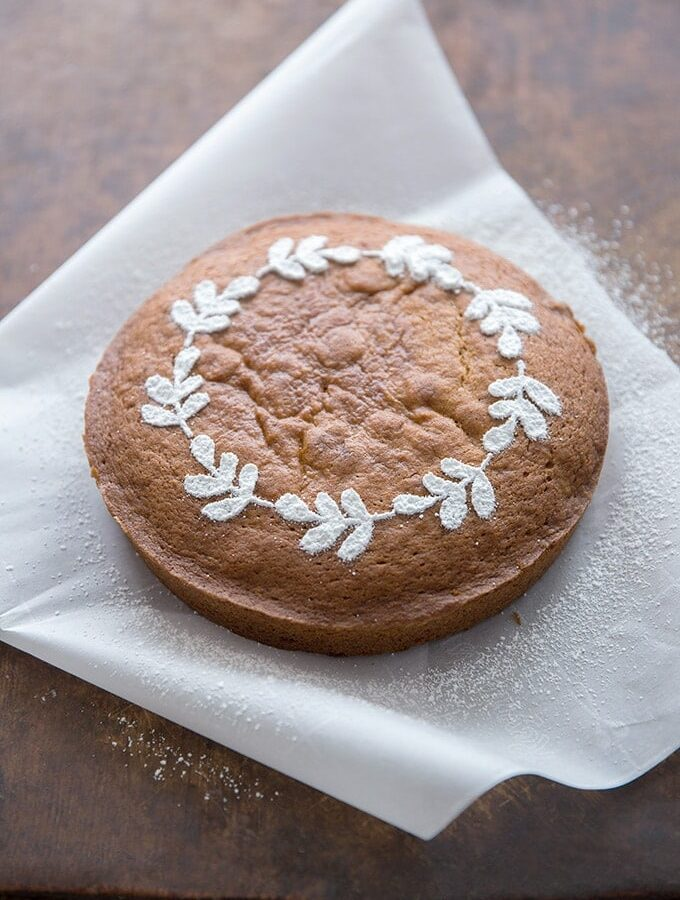 Fall cake stencil for easy and beautiful cake with beautiful powdered sugar leaf wreath.