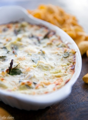 Warm, oven baked Spinach Artichoke Green Chile Dip served with fritos, bread or chips. The perfect warm appetizer!